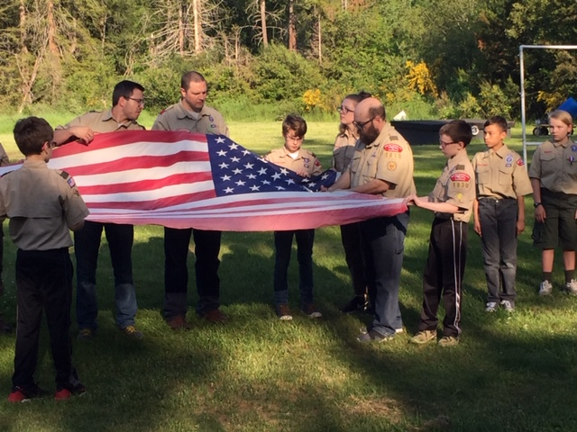 Scout Troops retire flag